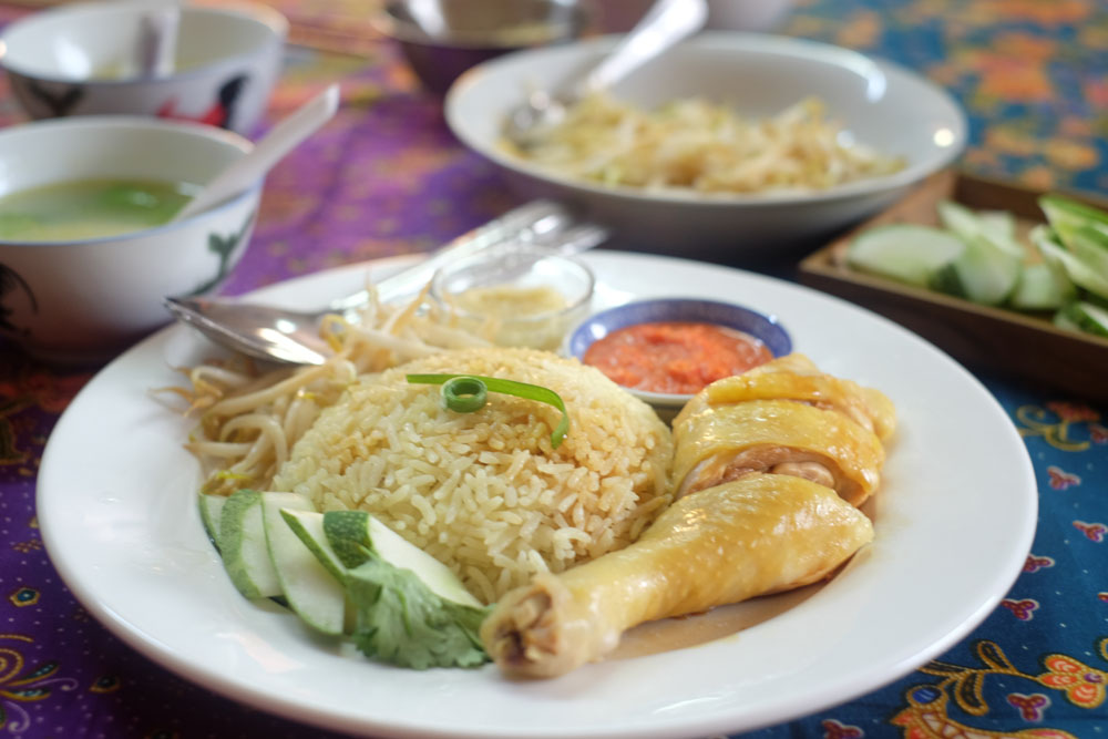 Enjoy your homemade Hainanese chicken rice with a local family