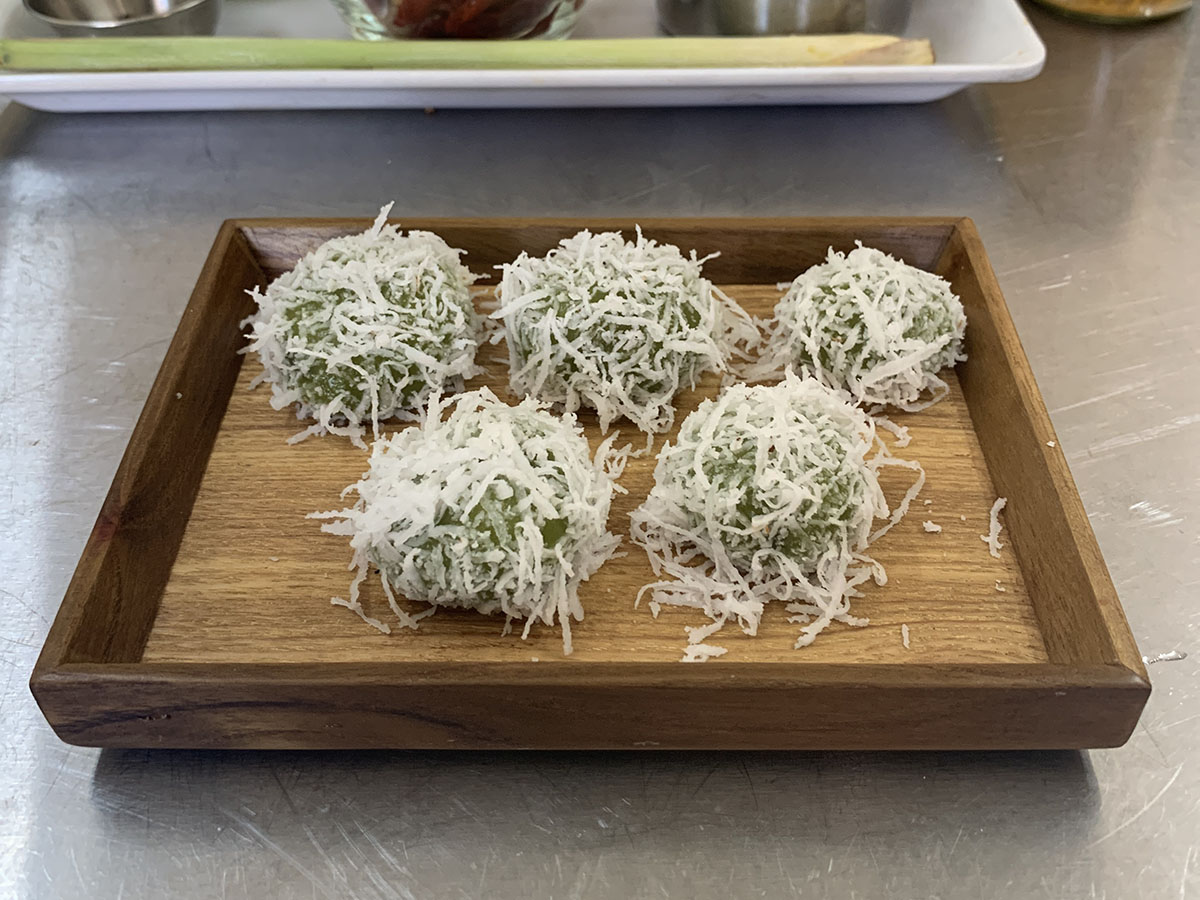 Ondeh-ondeh, a chewy ball with palm sugar & coconut flakes
